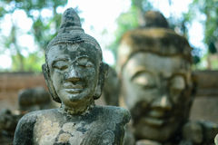 Antique image of Buddha focus on front object Stock Photography