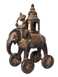 Antique Indian toy elephant. Antique Indian bronze toy elephant with canopy and mahut Stock Photography