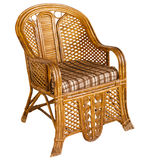 Antique indian wooden wicker armchair isolated on white. Antique wooden wicker armchair isolated on a white background. India Royalty Free Stock Images