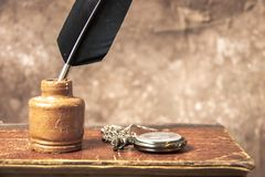 Antique inkwell and quill pen stock image