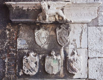 Antique inscriptions , venice lion and coats of arms Royalty Free Stock Photography