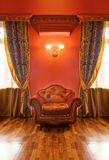 Antique interior with armchair Stock Images