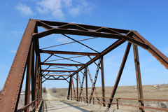 Rural Bridge. Antique iron bridge on gravel road in the country royalty free stock photo