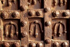 Antique iron door decorated with horseshoes Stock Photo