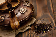 Antique iron hot tea pot on dark wooden background Stock Photography