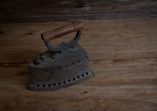 Antique iron, Old iron, Old coal iron on the old wooden floor.st Royalty Free Stock Image