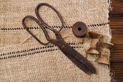 Really antique iron scissors with spools Royalty Free Stock Images