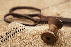 Really antique iron scissors with spools Stock Images
