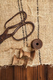 Really antique iron scissors with spools Stock Image