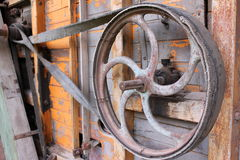 Antique iron wheel. Detail of antique iron wheel part of agricultural equipment in the 19th century Stock Images
