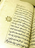 Antique islamic holy books. A handwritten old holy koran book of the Islam religion, opened and showing at close up the beauty of the arabian calligraphic Stock Photography