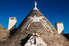 Antique italian house Trulli, Alberobello, Puglia - Italy. Trulli domes, traditional houses built with dry stone and conical roof, Alberobello, UNESCO World royalty free stock photo