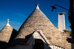 Antique italian house Trulli, Alberobello, Puglia - Italy. Trulli domes, traditional houses built with dry stone and conical roof, Alberobello, UNESCO World stock photos