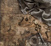 Antique items pocket watch scissors keys Nostalgic still life Royalty Free Stock Images