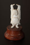 An antique ivory Buddha Stock Images