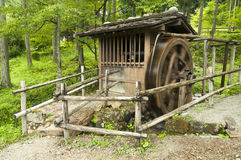 Antique japanese water mill Royalty Free Stock Image