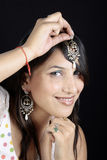 Antique jewellery. Indian girl with antique jewellery royalty free stock photo