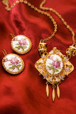 Antique jewelry. Very old jewelry on a red silk stock images