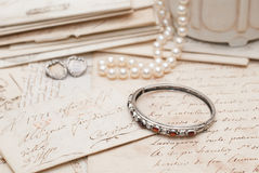Antique jewelry and letters Stock Photos
