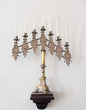 Antique jewish menorah and candles Stock Photography
