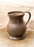 Antique jug. Old jug on a stone surface Royalty Free Stock Photo
