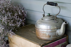 Antique kettle. Old-fashioned kettle in a rustic setting Royalty Free Stock Images