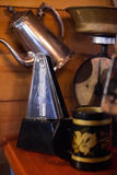 Antique kettle in dim light. Antiques in dim light. Old antique kettle Royalty Free Stock Photography