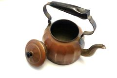 Antique kettle. Old antique kettle Stock Photo