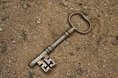 Antique key. On sand Stock Photo