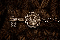 Antique Key. A background with a view of an antique key with a beautiful design on it Stock Photo