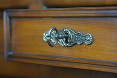 Antique key in a keyhole Royalty Free Stock Images