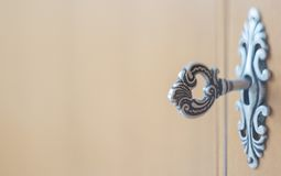 Antique key in a keyhole Stock Photo