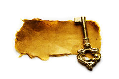 Antique key and paper Stock Photography
