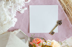 Antique key on paper. Single antique key on paper and decorative objects Royalty Free Stock Images