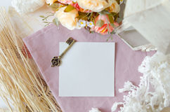 Antique key on paper. Single antique key on paper and decorative objects Royalty Free Stock Photos