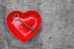 Antique key and a red heart Royalty Free Stock Photos