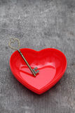 Antique key and a red heart Royalty Free Stock Photo