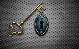 Antique key vault. Antique gold key and key hole on metal background Stock Photography