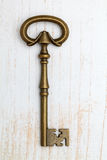 Antique key on wood background Stock Image