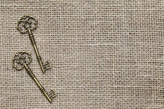 Antique keys. On burlap background Royalty Free Stock Photography