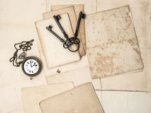 Antique keys and clock, old postcards and papers Royalty Free Stock Images