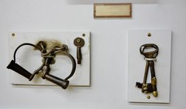 Antique keys and handcuffs from old prison montana. Historic artifacts from  Old Prison in state Montana remember that time when inmates were handcuffed by these Royalty Free Stock Image