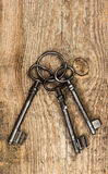 Antique keys over dirty wooden background Stock Image