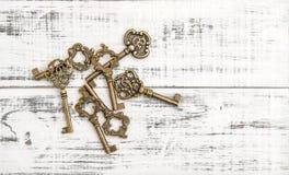 Antique keys rustic wooden background Nostalgic still life Royalty Free Stock Photo