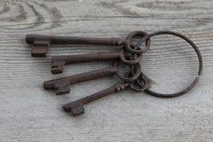 Old keys on weathered wood background Royalty Free Stock Image