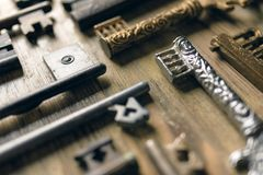 Antique keys on a wooden background.  Royalty Free Stock Photo