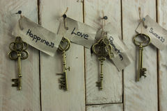 Antique keys on wooden background Royalty Free Stock Photos