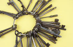 Antique Keys On A Yellow Background Stock Photo