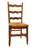 Antique kitchen chair. Antique wooden kitchen chair with basketweave seat Stock Photography