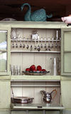 Antique Kitchen Cupboard. With cutlery and various glass and silver objects Stock Photo